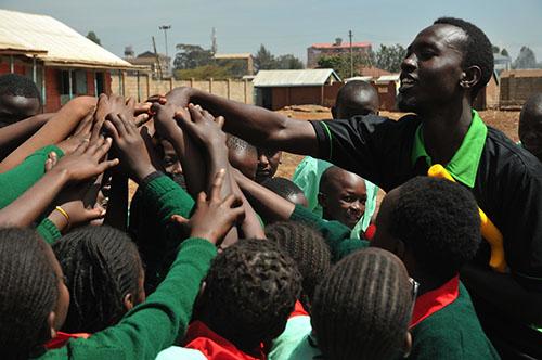 children with cricket coach in kenya